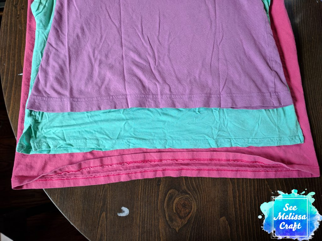 Shirts stacked for upcycled gir's skort
