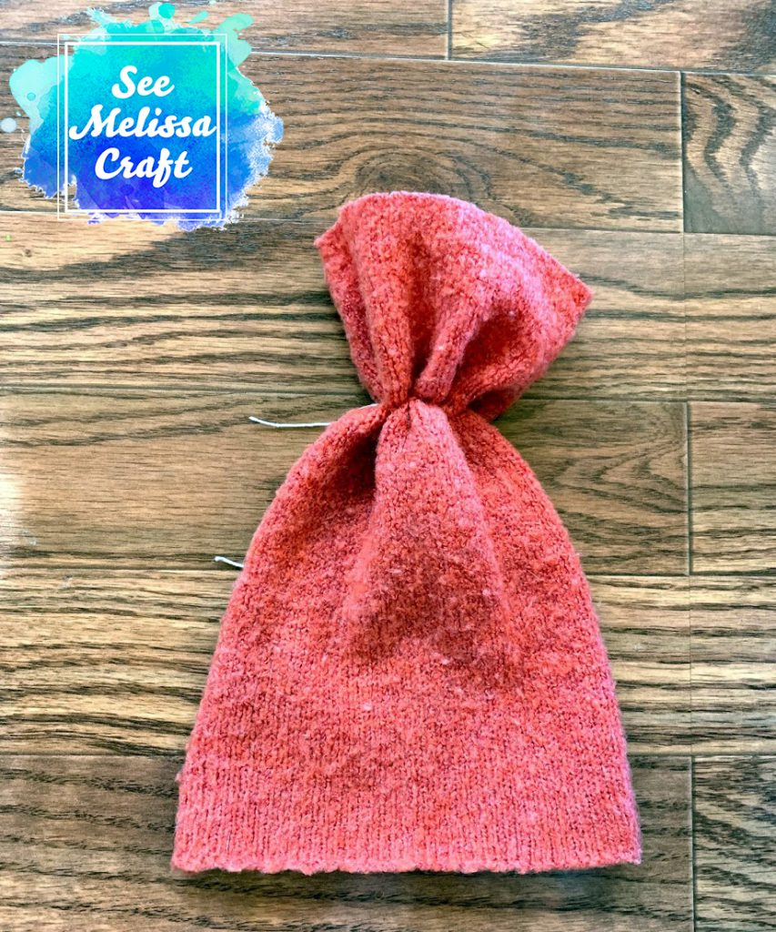 How to upcycle a sweater into a hat by gathering the top