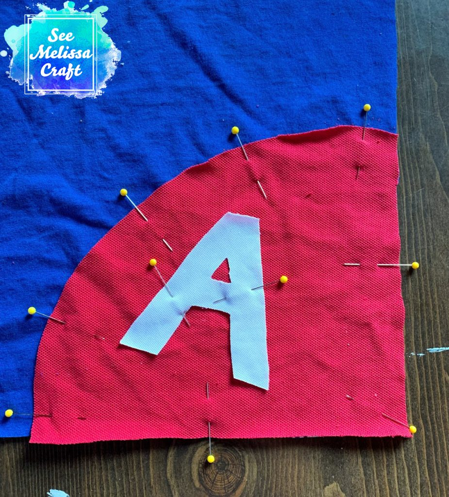 Additional applique pieces pinned on