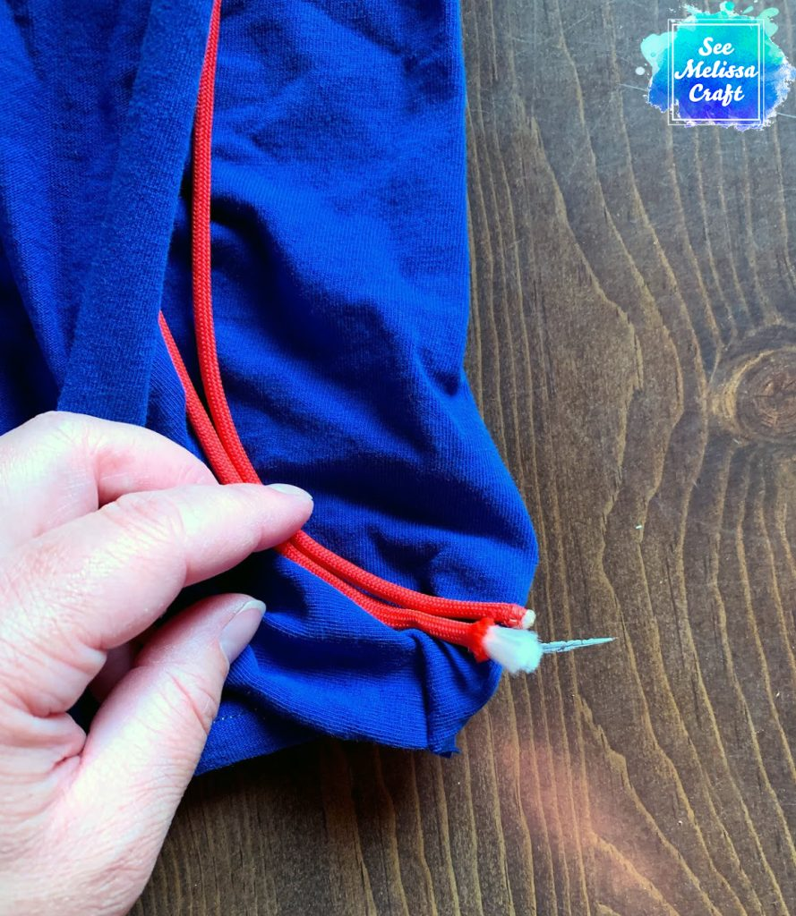 The ends should tuck against the bottom seam