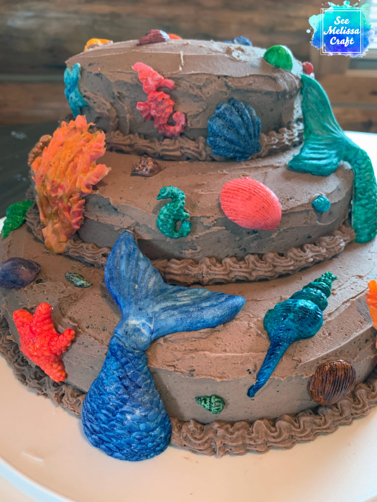 Close up of underwater fondant accents on cake