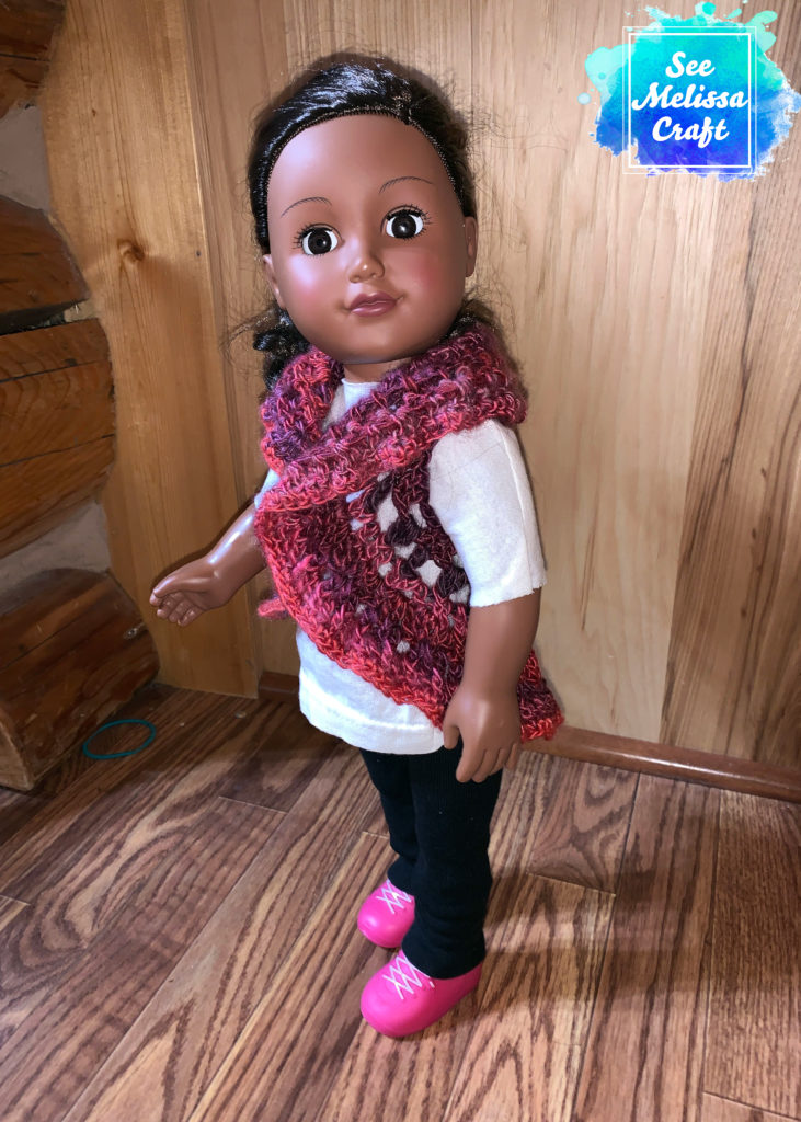 "Side view of 18"" doll crochet vest"